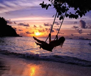 silhouette, swing, and swinging image