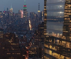 city, night, and buildings image
