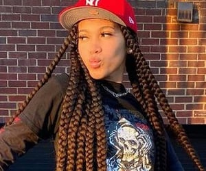 braids, cargo pants, and snapback image