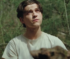 tom holland, the devil all the time, and actor image