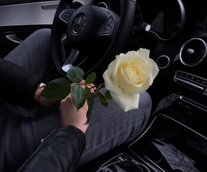 car, couple, and flowers image
