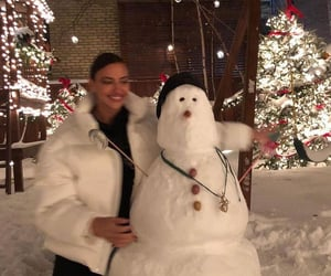 girl, snow, and snowman image