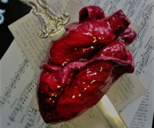 music notes, dagger, and heart image