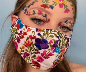 face paint, painted flowers, and flowers image