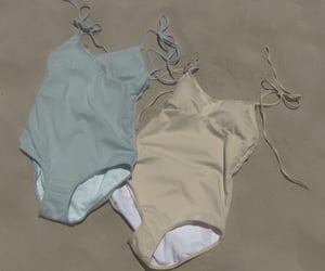 bathing suit, beach, and sand image