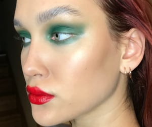 gold earrings, runway makeup, and model makeup image