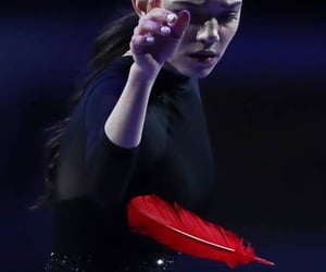 black dress, feather, and figure skating image