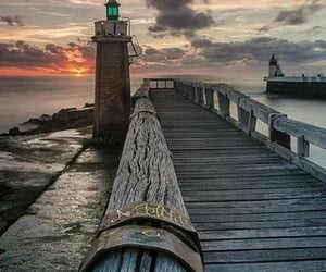 lighthouse, sky, and water image