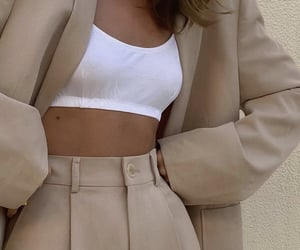 oversized blazer, white crop top, and chic elegant image
