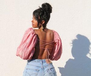 denim shorts, pink shirt, and tan image