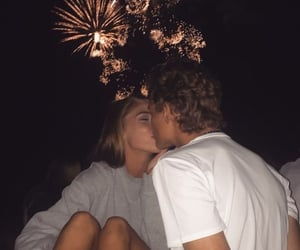 couple, kiss, and fireworks image