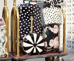 travel outfit ideas, branded travel bags, and traveling style image