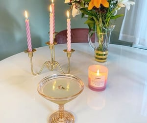 candles, flowers, and gold image