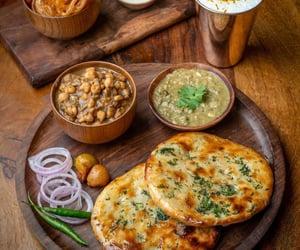 """""""Amritsari kulchas served with chhole"""""""