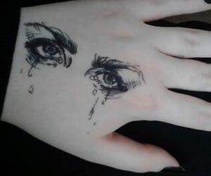 hand eye tattoo image