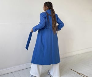 blue coat, white pants, and everyday look image