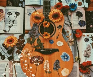 guitar, book, and flowers image