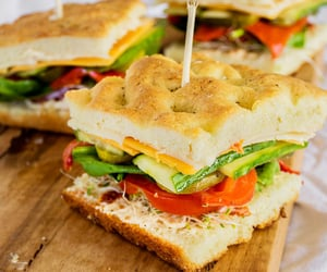 Stacked veggie sandwiches on focaccia with... - Nom-Food!
