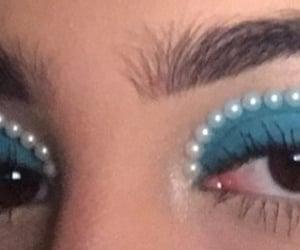 blue, blue eyeshadow, and brown eyes image