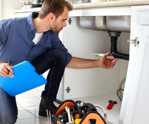 emergency plumber, drain cleaning, and tankless water heater image