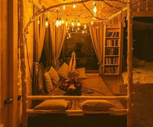 bed, books, and cabin image