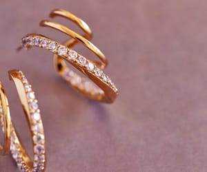 crystal, gold, and spiral earrings image