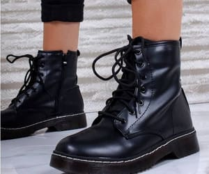 combat boots, tan vest, and leather pants image