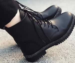 combat boots, leather pants, and tan vest image