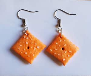 charms, crackers, and earrings image