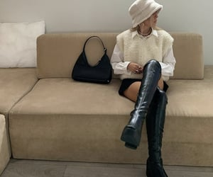 white button up, knee high boots, and black mini skirt image