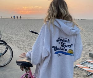 beach, exploring, and biking image