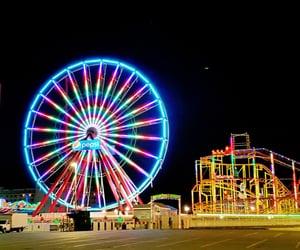 amusement park, coast, and ferris wheel image