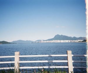 film camera, sea, and sky image