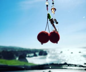 cherries, felted wool, and pom poms image