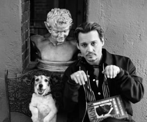johnny depp, dog, and black and white image