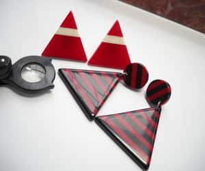 red black white, circle triangle, and plastic earrings image