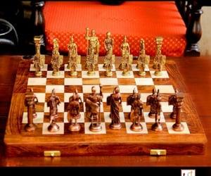 roman chess set, brass chess set, and standard chess board image