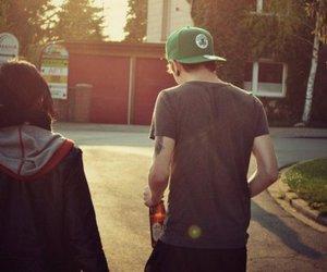 boy, girl, and cap image