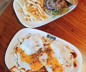pulled pork, burger, and ribs image