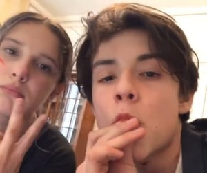 louis partridge and millie bobby brown image