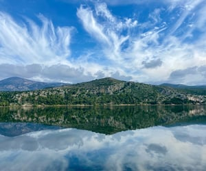 clouds, hills, and mirrored image