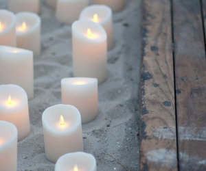 candle, sand, and beach image