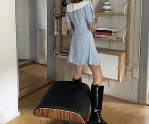 bookcase, reading, and knee high boots image