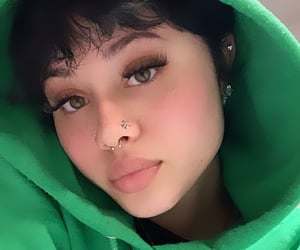 eye lashes, nose stud, and green image