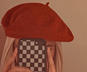 hat, phone, and red image