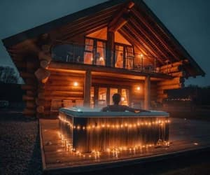 relaxing, jacuzzi hot tub, and way lit log cabin image
