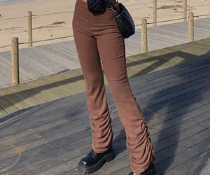 black shoes, everyday look, and brown trousers image