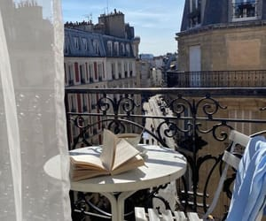 book, balcony, and city image