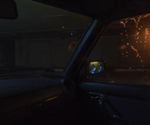 garage, music video, and passenger seat image