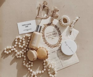 necklace, beige, and brand image
